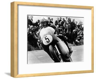 Mike Hailwood, on an Mv Agusta, Winner of the Isle of Man Senior TT, 1964