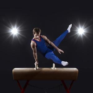 Male Gymnast on Pommel Horse by Mike Harrington