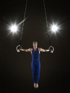 Male Gymnast on Rings by Mike Harrington