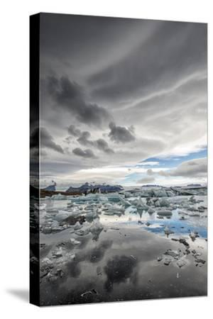 Icebergs in Glacial Lagoon with Stormy Sky