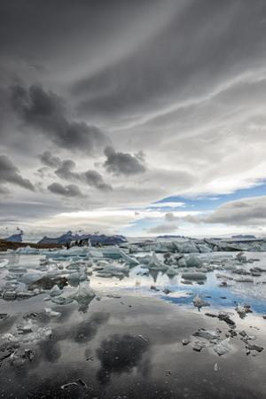 Icebergs in Glacial Lagoon with Stormy Sky by Mike Hill
