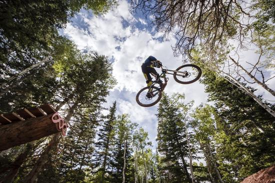 Mike Montgomery Jumping His Downhill Mountain Bike At Canyons Resort-Louis Arevalo-Photographic Print