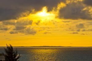 A Brilliant Yellow Sunset over Grace Bay in the Turks and Caicos Islands by Mike Theiss