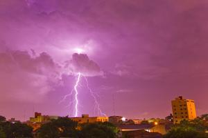 A Lightning Bolt Striking Down in the City of Asuncion, Paraguay During an Intense Lightning Storm by Mike Theiss