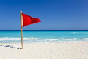 A Red Flag Is Posted as a Warning of Caution on the Beaches of Cancun, Mexico by Mike Theiss