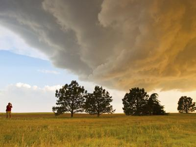 A Storm Chaser Watches a Massive Supercell Thunderstorm in Tornado Alley by Mike Theiss