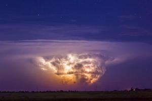 A Tornadic Supercell Thunderstorm, over 80 Miles Away, with a Large Tornado Touching Ground by Mike Theiss