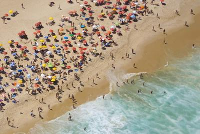 Aerial of large crowd at the Copacabana Beach in Rio de Janeiro.