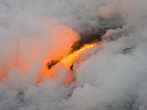 Break in Thick Gases Exposes Lava Flowing Off the Side Kilaua by Mike Theiss