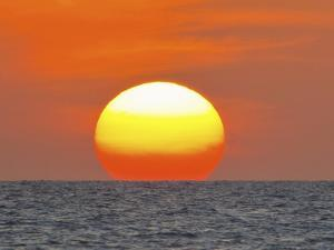 Close Up of the Sun Setting over the Gulf of Mexico by Mike Theiss