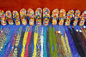 Colorful Jewelry and Sandals for Sale at an Outdoor Stand by Mike Theiss