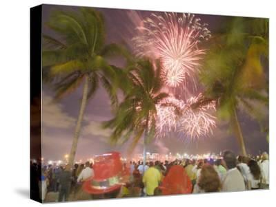 Crowd Gathered on New Year's Eve to Watch Fireworks Among the Palms