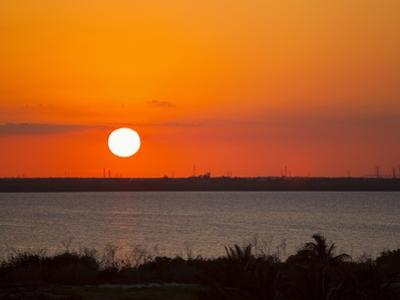 Dramatic Sunset over the Mainland in Cancun, Mexico by Mike Theiss