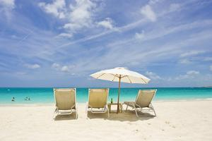 Empty Beach Chairs in the Sand on a Tropical Beach in the Caribbean by Mike Theiss