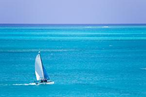 Sail Boaters Enjoying the Turquoise Waters of Grace Bay, in the Turks and Caicos Islands by Mike Theiss