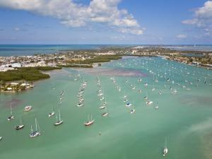 Sailboats Anchored in Orderly Rows in a Florida Key Lagoon by Mike Theiss