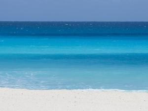 Shades of Blue Color the Beachfront Waters in Cancun, Mexico by Mike Theiss