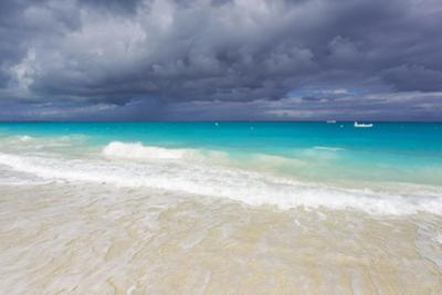 Storm Clouds Roll in over Turquoise Waters and a Beach by Mike Theiss