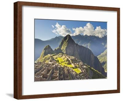 Sun Shining Through the Andes Mountains onto Machu Picchu at Sunset
