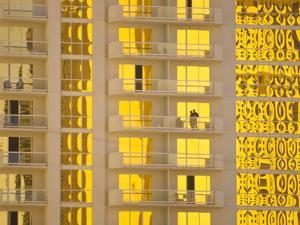 Sunlight Reflects Bright Gold on High Rise Casino Windows by Mike Theiss