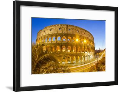 The Ancient Roman Colosseum Casts an Illuminated Golden Light at Dusk