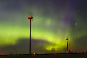 The Aurora Borealis or Northern Lights over a Wind Farm in North Dakota by Mike Theiss