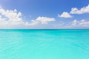 The Turquoise Waters of Grace Bay in the Turks and Caicos Islands by Mike Theiss