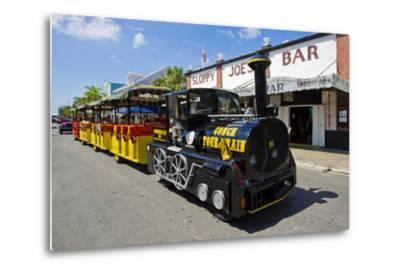 Tourists on the Famous Conch Train Get a Tour of Key West