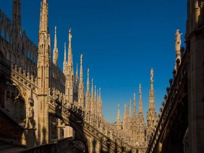 https://imgc.artprintimages.com/img/print/milan-milan-province-lombardy-italy-spires-on-the-roof-of-the-duomo-or-cathedral_u-l-q1blprp0.jpg?p=0
