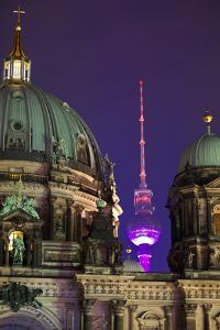 Close-Up of the Berliner Dom (Cathedral) with the Television Tower in the Background at Night by Miles Ertman