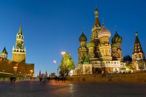 Red Square, St. Basil's Cathedral and the Savior's Tower of the Kremlin lit up at night, UNESCO Wor by Miles Ertman