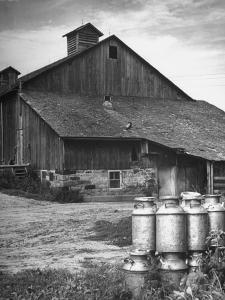 Milk Cans Being Stored on a Farm