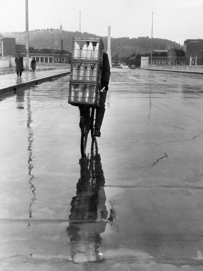 Milkman Riding on Slippery Road--Photographic Print