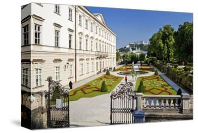 Mirabell Palace and Mirabell Gardens against Salzburg Cathedral and Fortress Hohensalzburg