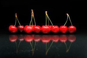 Cherries Against Black Background by mirceab