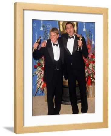 Actors Screenwriters Matt Damon and Ben Affleck Holding their Oscars in Press Room Atacademy Awards