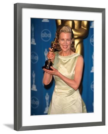Kim Basinger Holding Her Oscar in Press Room at Academy Awards