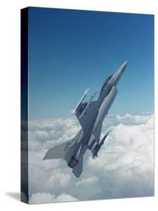 Missile-Armed Us F-16 Fighter Aircraft in Flight, Climbing Above Clouds