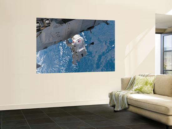 Mission Specialist Traverses the Station Hardware During Installation Day on the Space Station--Wall Mural