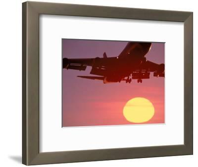 Airplane in Flight During Sunrise, Sunset