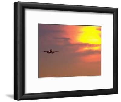 Commercial Airplane at Sunset