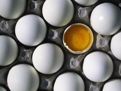 Cracked Egg in the Middle of Other Eggs