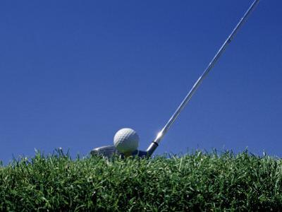 Golf Club Lined Up with Golf Ball on Tee by Mitch Diamond