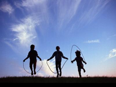 Silhouette of Children Playing Outdoors