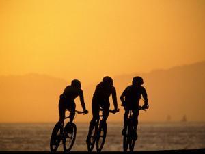 Silhouette of Three Men Riding on the Beach by Mitch Diamond