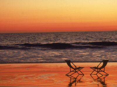 Silhouette of Two Chairs on the Beach