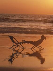 Silhouette of Woman in Beach Chair on the Beach by Mitch Diamond