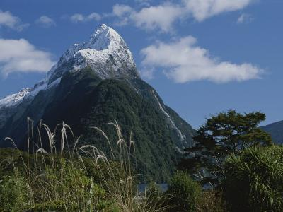 Mitre Peak in Milford Sound with Puffy White Clouds-Todd Gipstein-Photographic Print