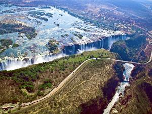 Aerial View of Victoria Falls, Waterfall, and the Zambesi River, Zimbabwe by Miva Stock