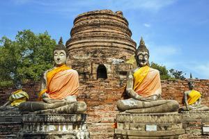Ayutthaya, Thailand. Large Buddha at Wat Phra Mahathat, Ayutthaya Historical Park, near Bangkok. by Miva Stock